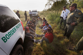 Border Patrol agents detain undocumented immigrants apprehended near the Mexican border on May 28, 2010 near McAllen, Texas.