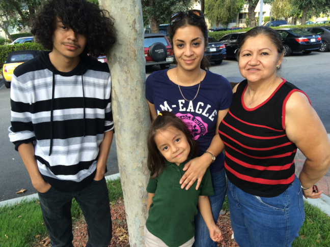 Karen Gonzalez, center, lived through years of domestic violence that her children witnessed. On a recent afternoon, the family —14-year-old Jonathan, 6-year-old Leilani and the children's grandmother, Martha Romero wait for therapy appointments to begin. Gonzalez has learned how to use