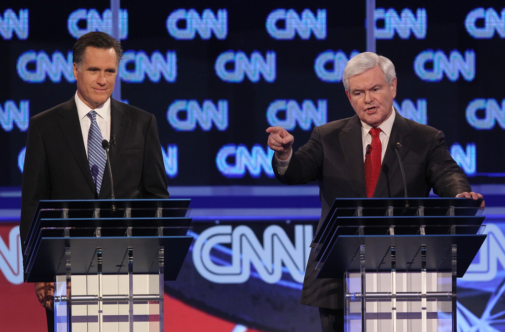 CHARLESTON, SC - JANUARY 19:  Republican presidential candidate former Speaker of the House Newt Gingrich (R), next to former Massachusetts Gov. Mitt Romney, makes a point during the opening question of a debate at the North Charleston Coliseum January 19, 2012 in Charleston, South Carolina.