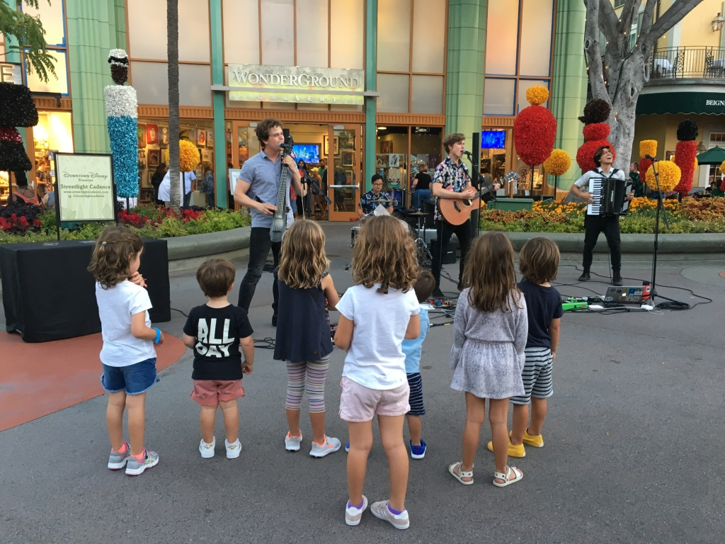 The band Streetlight Cadence performs for a group of kids at Downtown Disney, Anaheim. Credit/Beidi Zhang