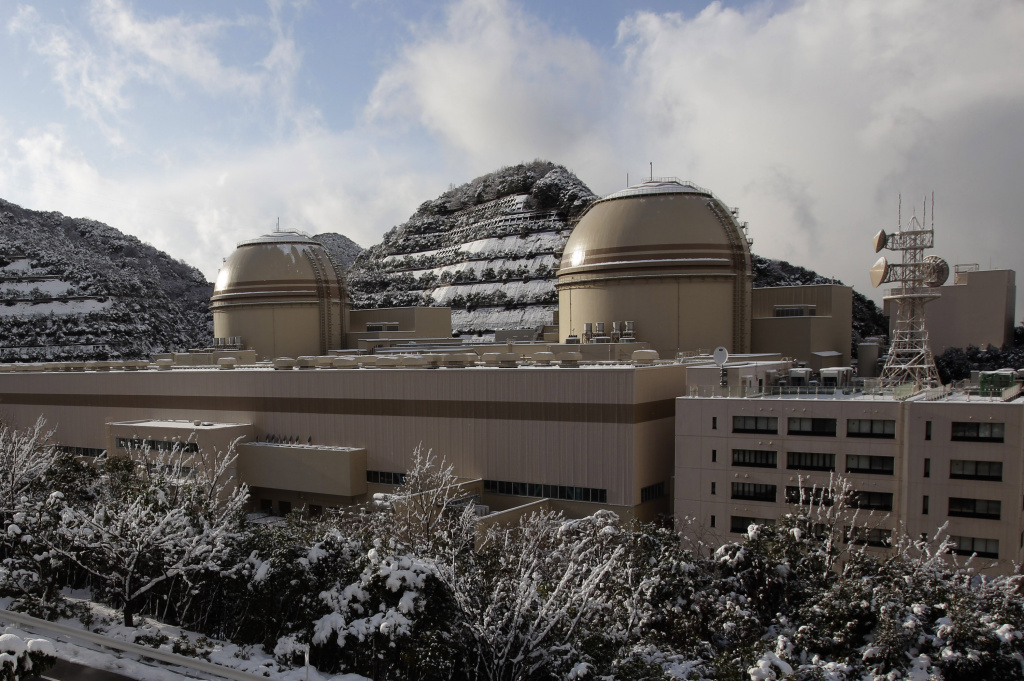 In this Jan. 26, 2012 file photo, Kansai Electric Power Co's Ohi nuclear power plant No. 3, right, and No. 4 reactors are seen in Ohi, Fukui prefecture, western Japan, as experts from the International Atomic Energy Agency conduct their first inspection of the Japanese nuclear power plant.