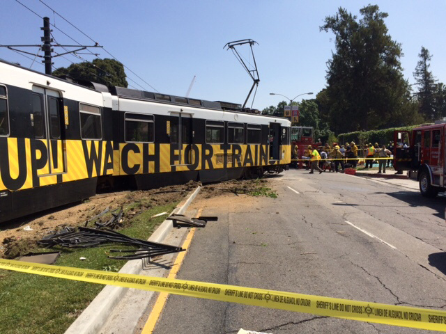 Cars from Metro's Expo Line derailed from a collision with an automobile along Exposition Boulevard near Vermont Avenue Saturday morning, March 28, 2015.