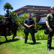 A line of police officers guard the Anaheim Police Department before a protest to show outrage for the several recent officer-involved shootings on July 29, 2012 in Anaheim, California.