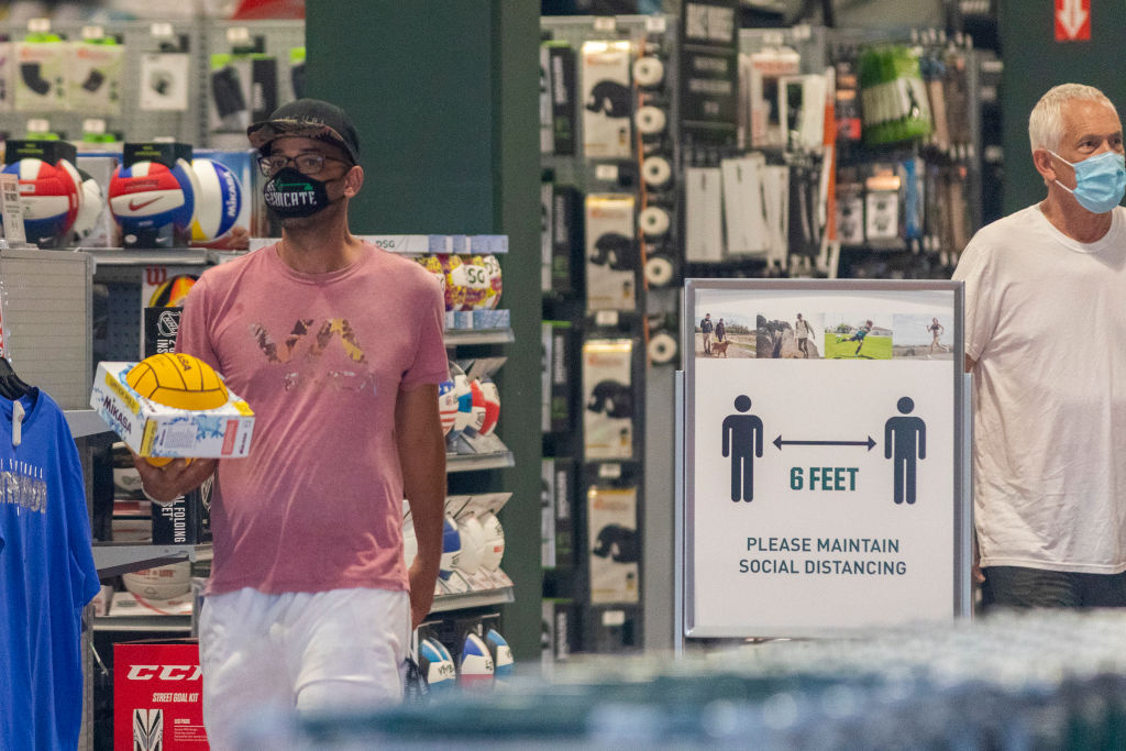 Customers shop in a Dick's Sporting Goods store as Los Angeles County retail businesses reopen while the COVID-19 pandemic continues on May 27, 2020 in Glendale, California.