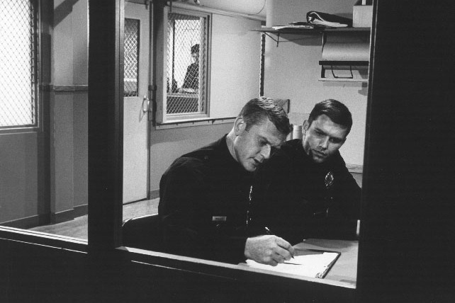 Martin Milner (L) and Kent McCord film a scene of the NBC series
