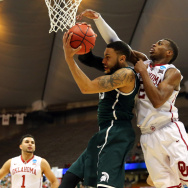 Oklahoma's Buddy Hield, right, and Denzel Valentine of Michigan State played in Friday's East Regional Semifinal of the 2015 NCAA tournament in Syracuse. If you've got money riding on this year's NCAA tournament, you might want to hear about what happened