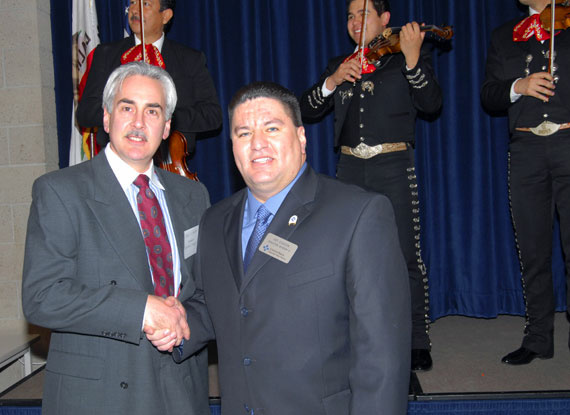 An undated photo showing the installation of Central Basin Water District board member Art Chacon (right), from the district's official website.