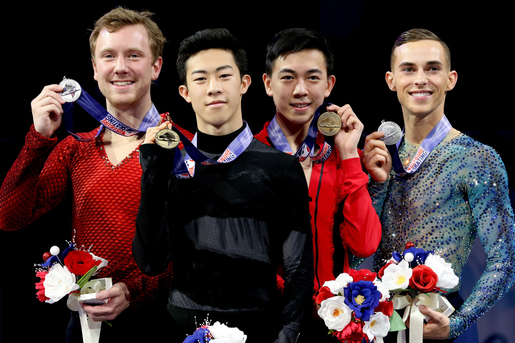 Ross Miner, Nathan Chen, Vincent Zhou and Adam Rippon pose for photographers after the medal ceremony for the Championship Men's during the 2018 Prudential U.S. Figure Skating Championships at the SAP Center on January 6, 2018 in San Jose, California.
