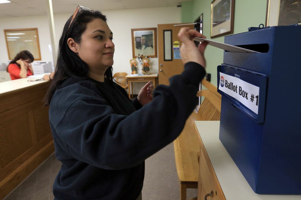 Miranda Reyes of Limon, casts her ballot at the Lincoln County Courthouse on November 6, 2012 in Hugo, Colorado. Colorado is a swing state garnering nine electoral votes in the presidential race.