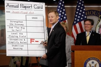 House Financial Services Committee Chairman Spencer Bachus (R-AL) adds a grade of F- to a 'report card' for the Dodd-Frank Act one year after the legislation passed July 15, 2011 in Washington, DC.