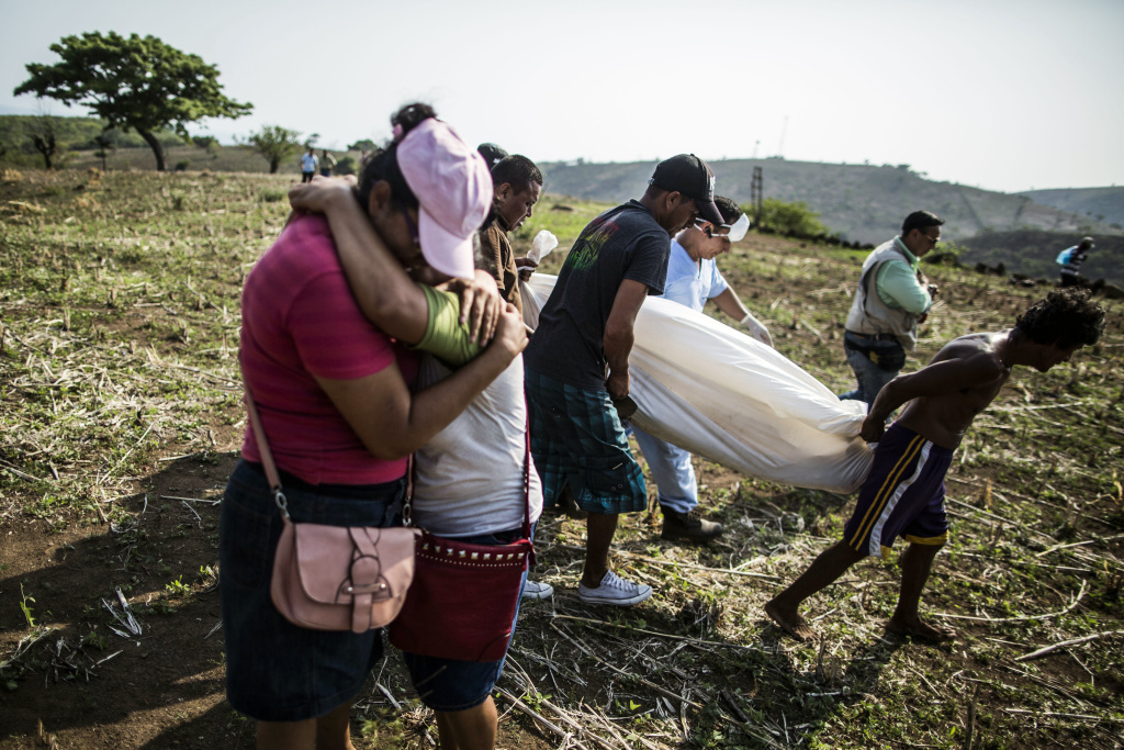 A daughter embraces her mother after relatives of Alberto Hernández retrieve his body, in a rural area near Caserío el Chumpe, El Salvador. Police believe that the 42-year-old made his living as a driver and was kidnapped and killed by gang members. His body was discoveredat a clandestine grave site by family members who spotted vultures circling overhead. (AP Photo/Manu Brabo)