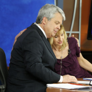 WDBJ-TV news morning anchor Kimberly McBroom, center, gets a hug from visiting anchor Steve Grant, left, as meteorologist Leo Hirsbrunner reflects after their early morning newscast at the station on Thursday.
