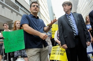 Journalist Maziar Bahari (L) and Head of Amnesty International Larry Cox speak during a rally calling for Iranian officials to reverse prison sentences of Jafar Panahi and Mohammad Rasoulof on June 8, 2011 in New York City.