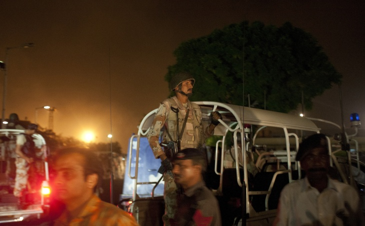 Pakistani security personnel gather outside the Jinnah International Airport after the militants' assault in Karachi, late on June 8, 2014. Heavily armed militants attacked Pakistan's busiest airport in the southern city of Karachi Sunday night, killing at least five people as flights were suspended and the army was called in, officials said.
