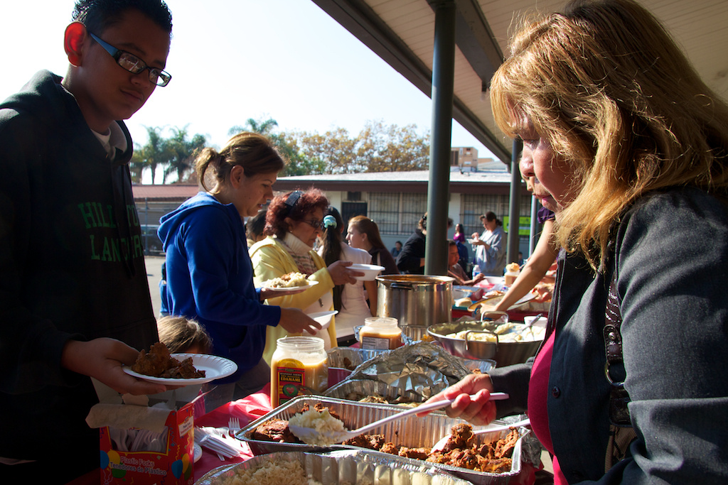 Volunteer Guadalupe Flores passes out food during a event by the Coalition for Humane Immigrant Rights of Los Angeles on November 23, 2011. CHIRLA also handed out food baskets to needy North Hollywood community members.