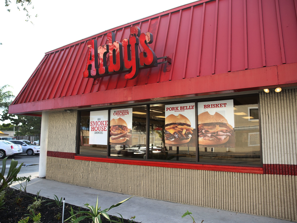Arby's is among seven fast-food chains that have agreed to stop limiting their workers' ability to take jobs at other restaurants in the same chain.