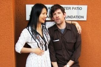 Gwendoline Yeo (R) and KPCC's John Rabe, outside the Mohn Broadcast Center.