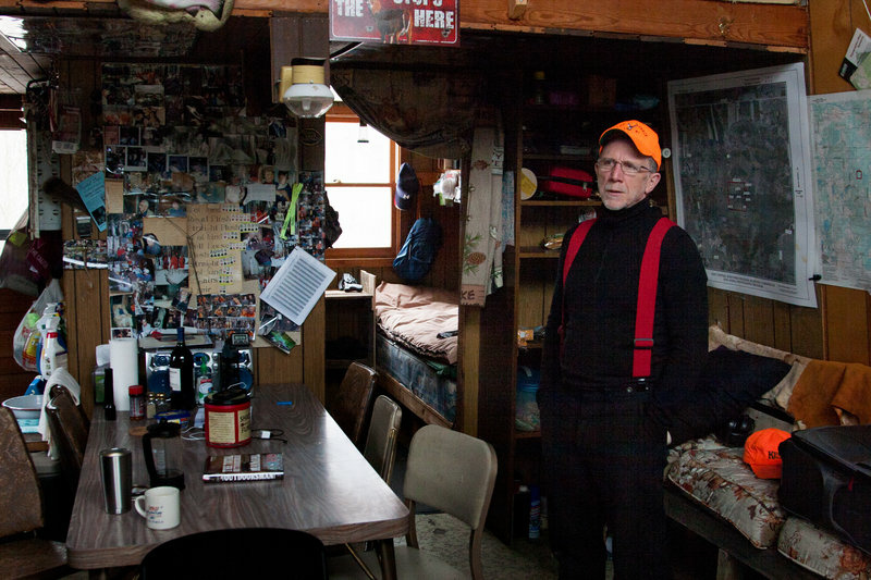 Tom Wrasse is alone at his hunting shack on the last day of a deer hunting season.