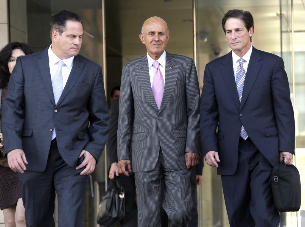 Former Los Angeles County Sheriff Lee Baca, center, leaves federal court in Los Angeles with attorneys David Hochman, left, and Nathan Hochman after his corruption trial went to the jury Monday, March 13, 2017, in Los Angeles.
