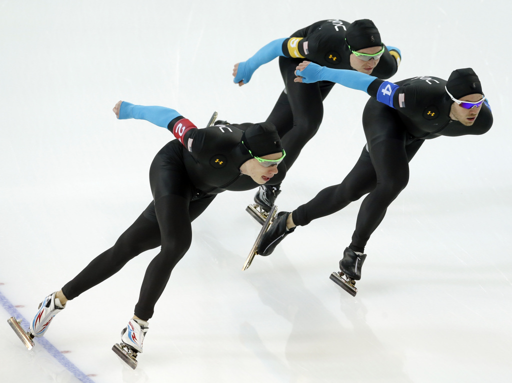 Speed skaters from the U.S., Brian Hansen, left, Jonathan Kuck, back, and Joey Mantia, right, compete in the team pursuit speedskating race for the seventh place at the Adler Arena Skating Center at the 2014 Winter Olympics, on Saturday.