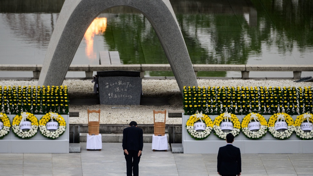 Japanese Prime Minister Shinzo Abe bows in front of a memorial to people who were killed in the 1945 atomic bombing of Hiroshima.