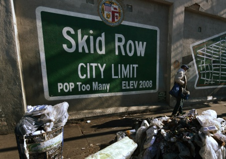 Trash lies beside the Skid Row City Limit mural as the city begins its annual homeless count in Los Angeles, California on January 26, 2018.