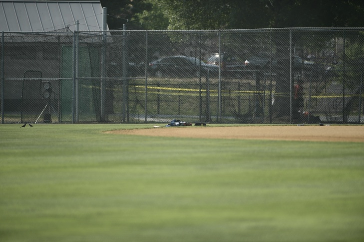 A member of the Alexandria Police stands guard near the scene where a man opened fire at a Congressional baseball practice on June 14, 2017.