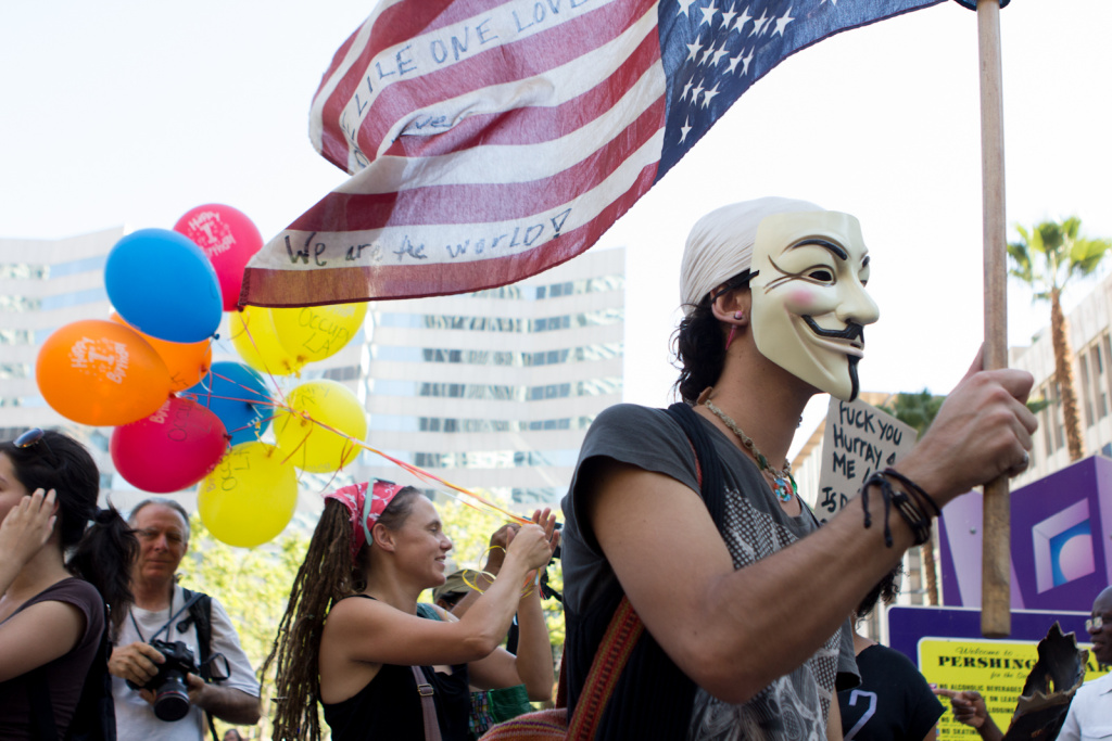 Protestors gathered on the steps of Pershing Square on the one year anniversary of Los Angeles' Occupy movement in Los Angeles, Calif., Monday, October 1, 2012. More than 300 protestors gathered at Pershing Square and marched around downtown.