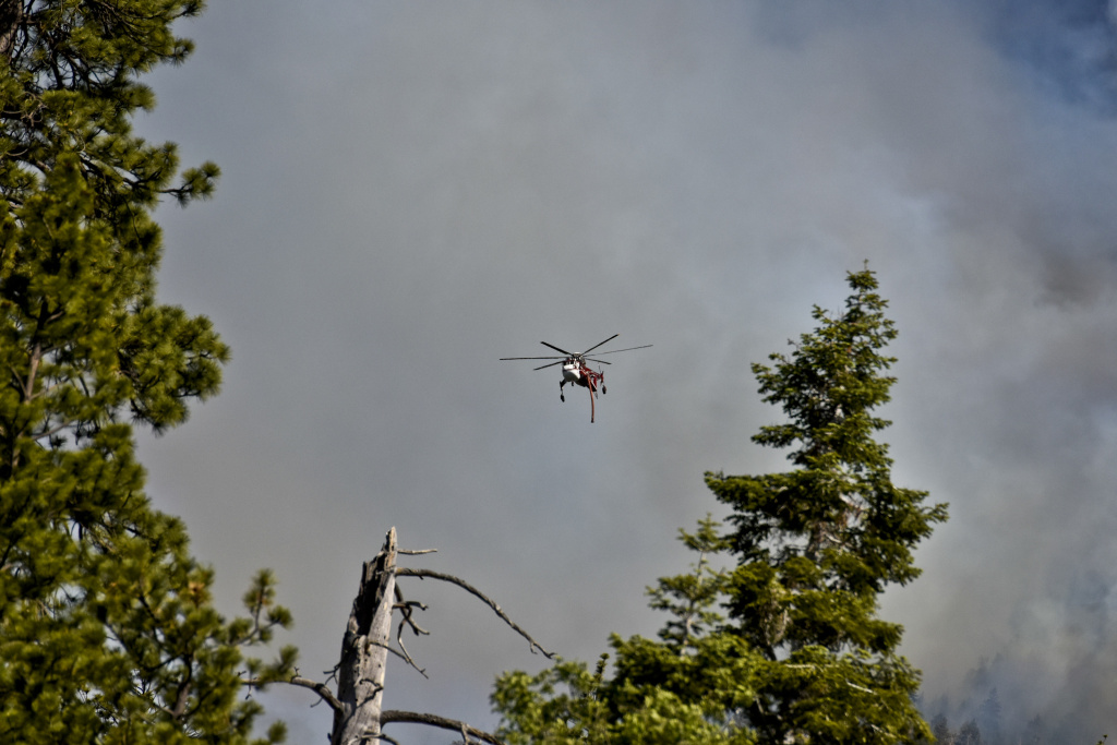 A helicopter flies over the Lake Fire off Jenks Lake Road in the San Bernardino National Forest last Thursday, June 18, 2015. Firefighters have been filling up helicopters using ponds normally reserved for making snow in the winter at Big Bear Mountain Resorts.