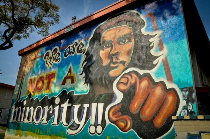 Street murals are scattered across Boyle Heights from storefronts to public buildings. Many, like this one in Estrada Gardens, carry political messages.