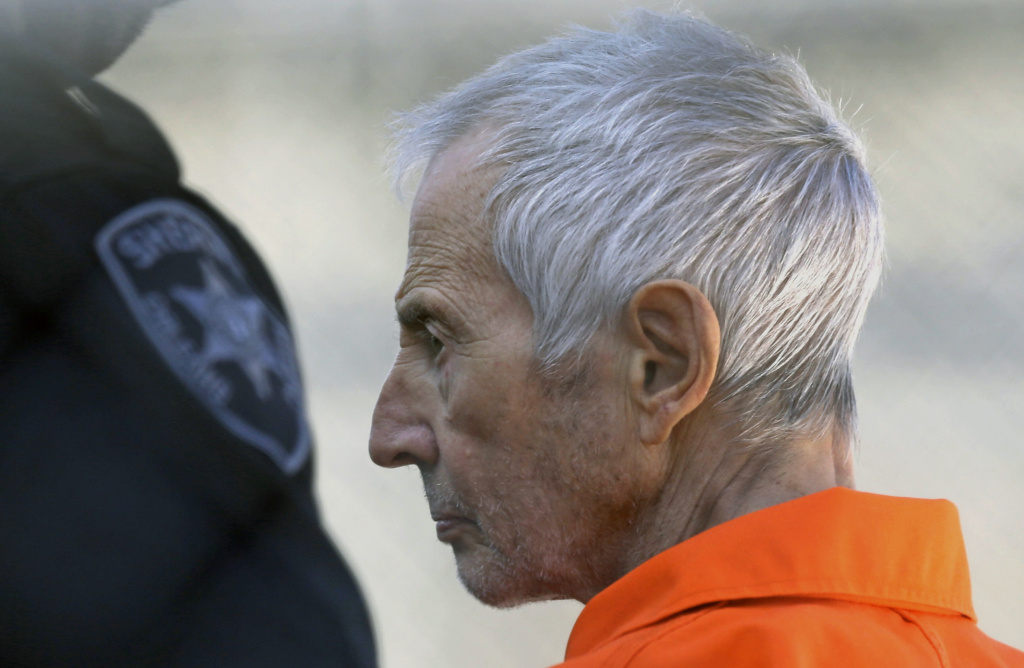 In this Tuesday, March 17, 2015, file photo, Robert Durst is escorted into Orleans Parish Prison after his arraignment in Orleans Parish Criminal District Court in New Orleans. On Wednesday, April 8, 2015, a grand jury charged Durst with possession of a firearm by a felon and with possession of both a firearm and an illegal drug.
