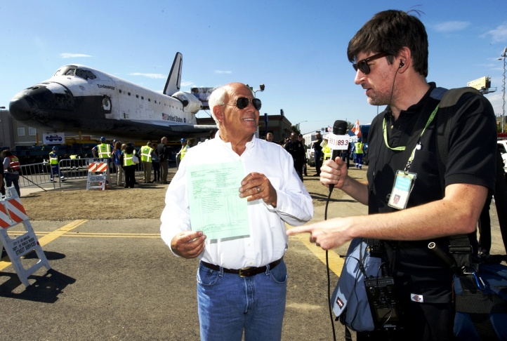 Steve Soboroff shows John Rabe the bill of sale for Shuttle Endeavour 11-12-12