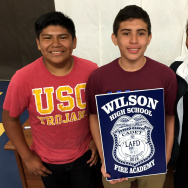 Israel Quinillo, Matthew Ruiz, and Genesis Williams are part of the first class in Wilson High's new firefighting magnet school.