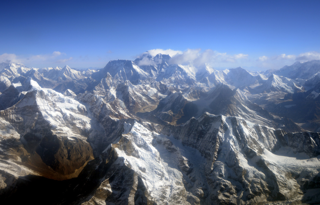 This photograph taken from an aircraft shows an aerial view of Mount Everest (C) and The Himalayan mountain range, some 140kms (87 miles) north-east of Kathmandu on April 3, 2013, on the 80th anniversary of the first manned flight over Mount Everest, the world's tallest mountain. This year is the 60th anniversary of the first summit of the 8848-metre peak.