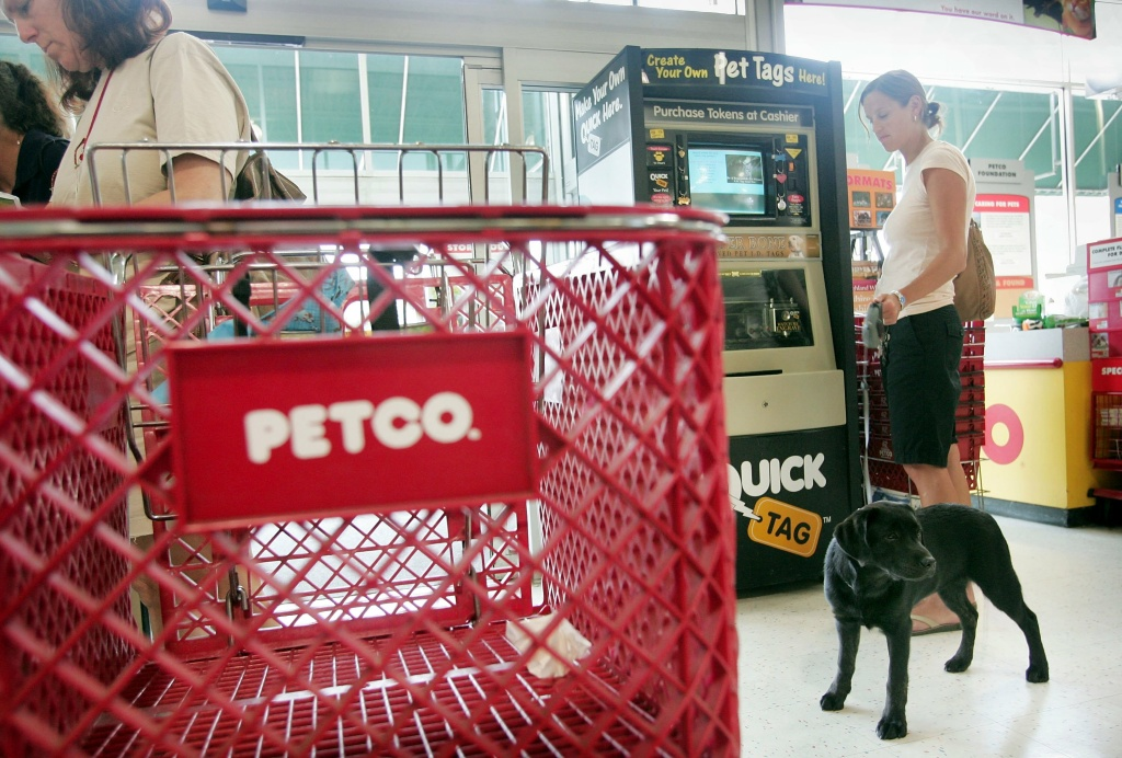 Shoppers look over the merchandise at a Petco store in this July 14, 2006 file photo taken in Chicago, Illinois. Petco, now known as Petco Holdings Inc., was acquired by private equity firms TPG Global and Leonard Green & Partners later that year but said Monday, August 17, 2015, that it expects to raise $100 million in an initial public offering as it goes public again.