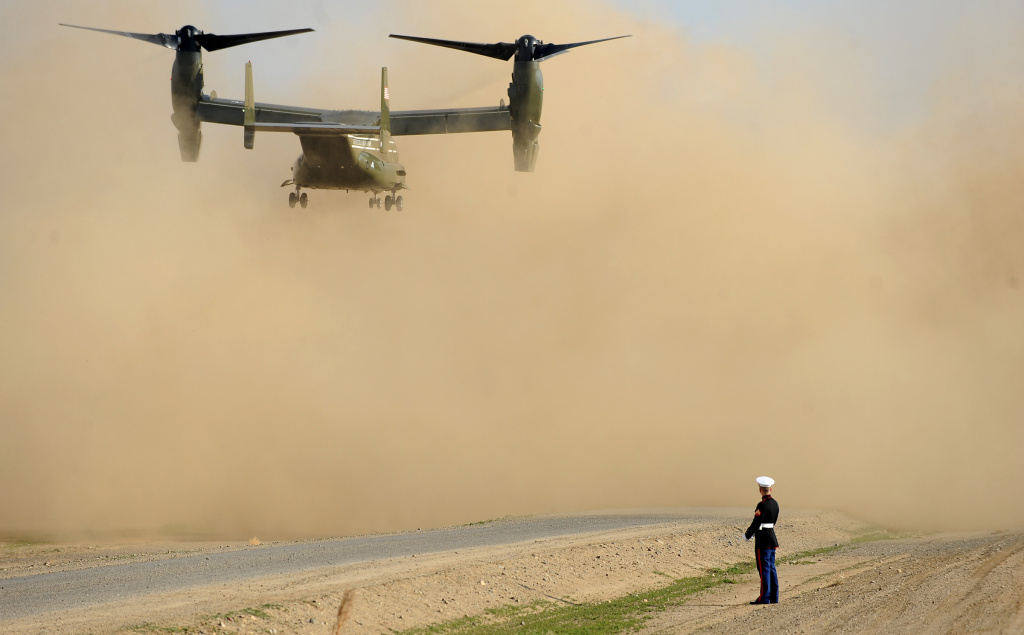 A U.S. Marine watches as an Osprey helicopter lands in Los Banos, California Friday, February 14, 2014. US President Barack Obama arrived on Marine 1 to address the drought situation.