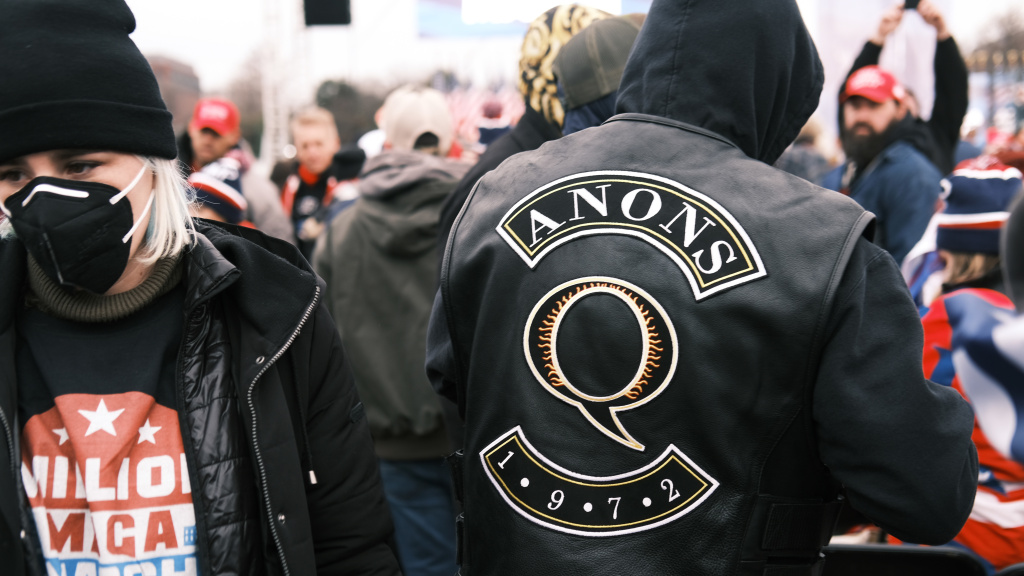 A QAnon supporter attends the Jan. 6