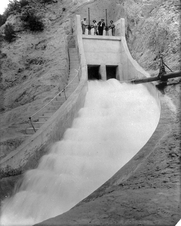 "View of ""Cascades"" marking the terminus of Los Angeles Aqueduct at the southern end of the Newhall Pass in what would be present day Sylmar. The original cascade of water can still be seen when traveling on Interstate 5 through Sylmar in the San Fernando Valley. On November 5, 1913, over 40,000 Los Angeles residents came to the San Fernando Valley to see the first water from the Owens Valley complete the journey to Los Angeles."