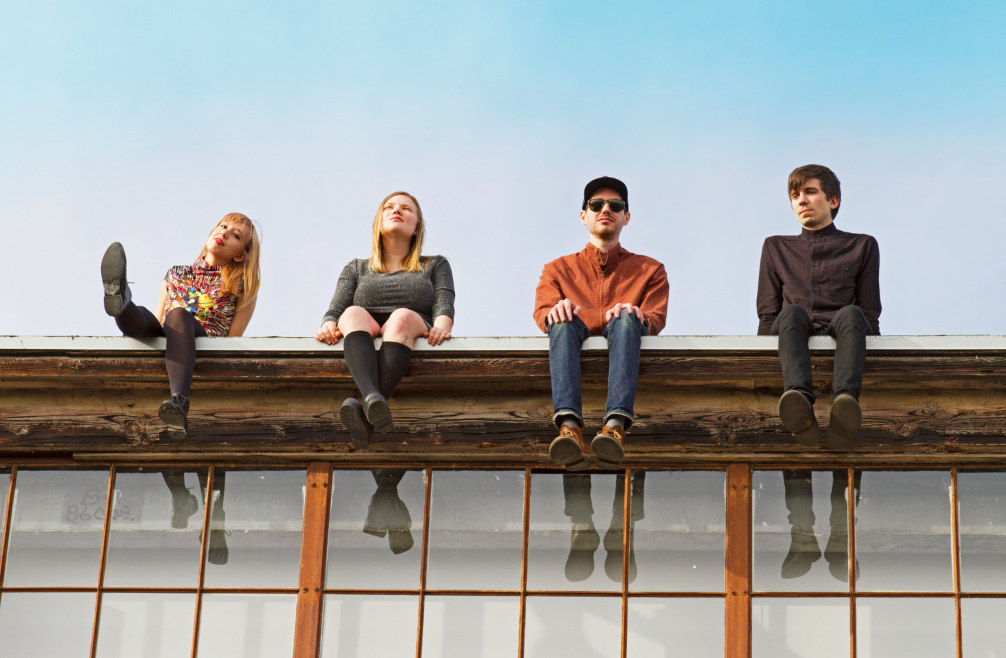Dunes, the Los Angeles band, sitting on a roof