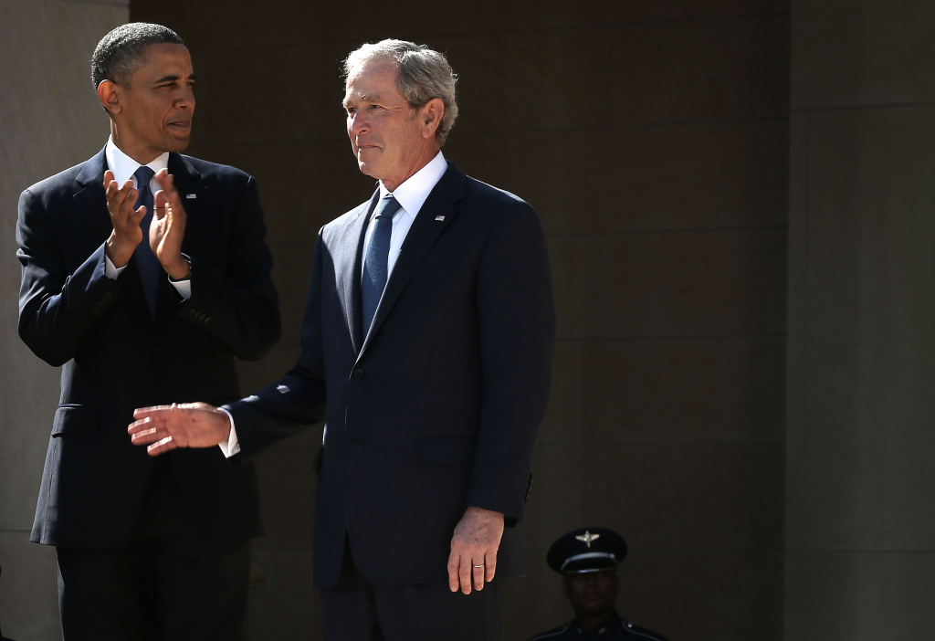 U.S. President Barack Obama (L) and former President George W. Bush (R) arrive at the opening ceremony of the George W. Bush Presidential Center April 25, 2013 in Dallas, Texas. The Bush library, which is located on the campus of Southern Methodist University, with more than 70 million pages of paper records, 43,000 artifacts, 200 million emails and four million digital photographs, will be opened to the public on May 1, 2013. The library is the 13th presidential library in the National Archives and Records Administration system.