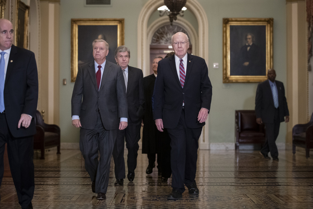 Sen. Lindsey Graham, Sen. Roy Blunt, Supreme Court Chief Justice John Roberts and Sen. Pat Leahy arrive to the Senate chamber for impeachment proceedings at the U.S. Capitol on January 16, 2020 in Washington, DC.