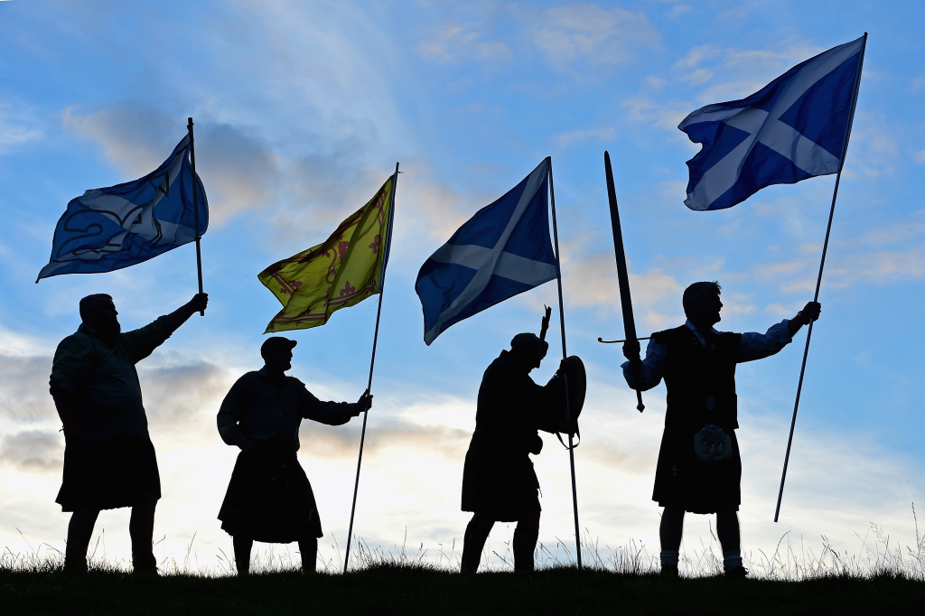 Duncan Thomson, Brian McCutcheon, John Patterson and Arthur Murdoch,from King of Scots Robert the Bruce Society, hold the Scottish flags as they prepare to vote in the Scottish independence referendum on September 14, 2014 in Loch Lomond.