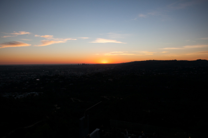 Fans gather to watch the sunset at Huell Howser's public memorial at Griffith Observatory, Tuesday, Jan. 15, 2013.