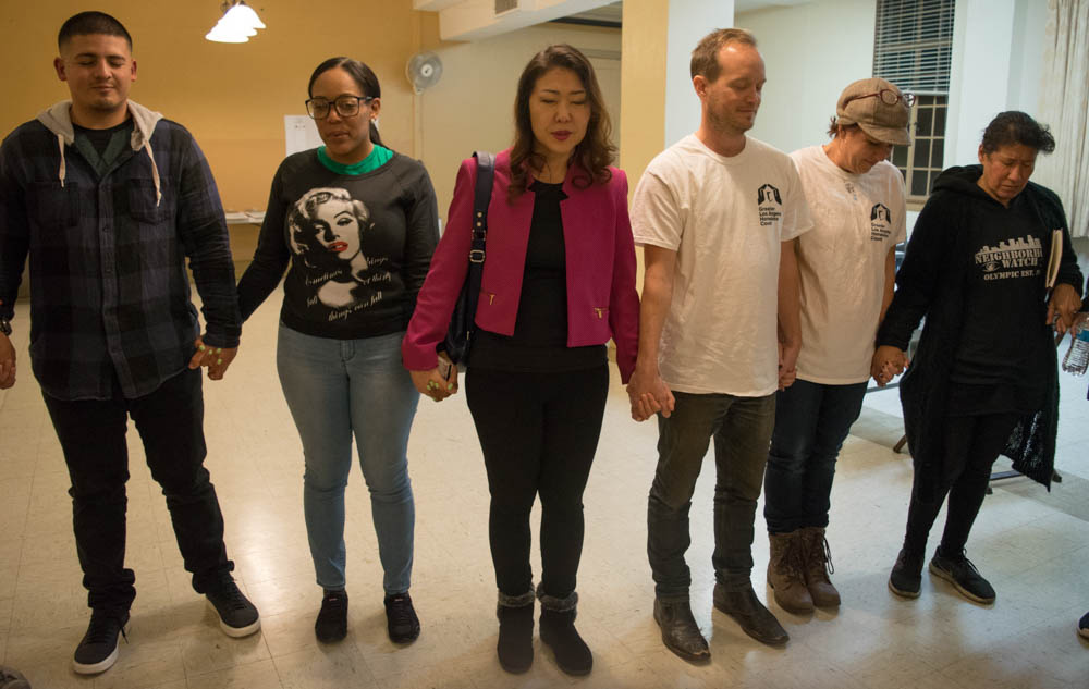 Hyepin Im joins other volunteers in a time of prayer before the 2018 Koreatown Homeless Count on Jan. 25, 2018. The volunteers had a joint time of prayer in English, than individual prayer time in several languages, including Spanish and Korean.