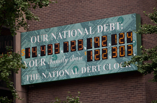 The National Debt Clock, a billboard-size digital display showing the increasing US debt, is seen on the corner of Sixth Avenue and West 44th Street on August 1, 2011 in New York City.