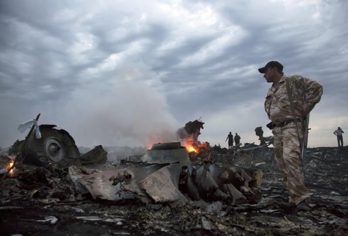 Smoke rises up at a crash site of a passenger plane, near the village of Grabovo, Ukraine, Thursday, July 17, 2014.