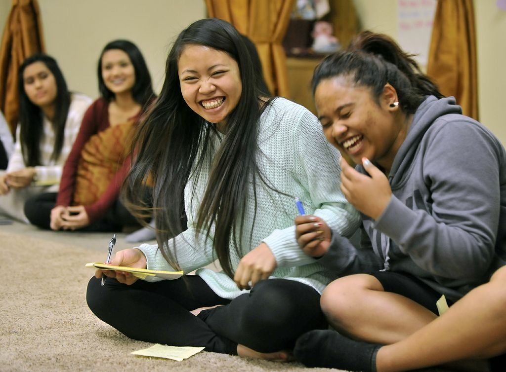 Girls laugh during a group debate exercise at the Khmer Girls in Action offices in Long Beach. Cambodia Town, officially recognized by the Long Beach City Council in 2007, is a hub for about 44,000 Cambodians living in Los Angeles and Orange counties.
