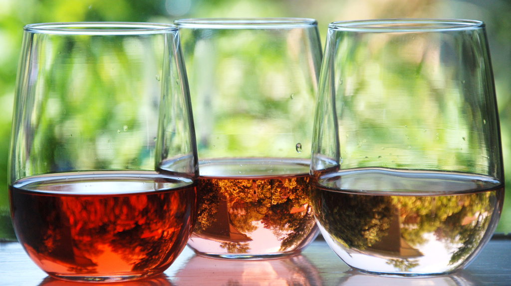 The intensity of pink color in rosé wine comes from the amount of skin contact the grape juice has with the grape skin in the winemaking process.