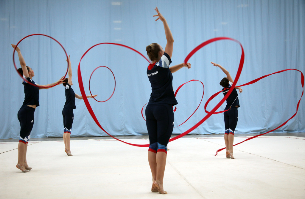 Members of the Great Britain Rhythmic Gymnastics Team practice their routine on July 18, 2012 in Bath, England. The team have been preparing for the London 2012 Olympics at the Sports Training Village at the University of Bath.