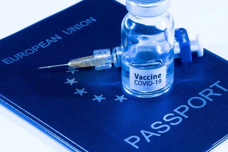 A picture taken on March 3, 2021 in Paris shows a vaccine vial reading